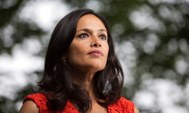 Image description: photograph of Tishani Doshi, a middle aged woman with dark wavy hair wearing a red dress.